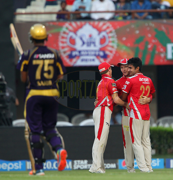 David Miller, George Bailey and Karanveer Singh of the Kings X1 Punjab celebrate the wicket of Shakib Al Hasan of the Kolkata Knight Riders during the first qualifier match (QF1) of the Pepsi Indian Premier League Season 2014 between the Kings XI Punjab and the Kolkata Knight Riders held at the Eden Gardens Cricket Stadium, Kolkata, India on the 28th May  2014<br /> <br /> Photo by Ron Gaunt / IPL / SPORTZPICS<br /> <br /> <br /> <br /> Image use subject to terms and conditions which can be found here:  http://sportzpics.photoshelter.com/gallery/Pepsi-IPL-Image-terms-and-conditions/G00004VW1IVJ.gB0/C0000TScjhBM6ikg