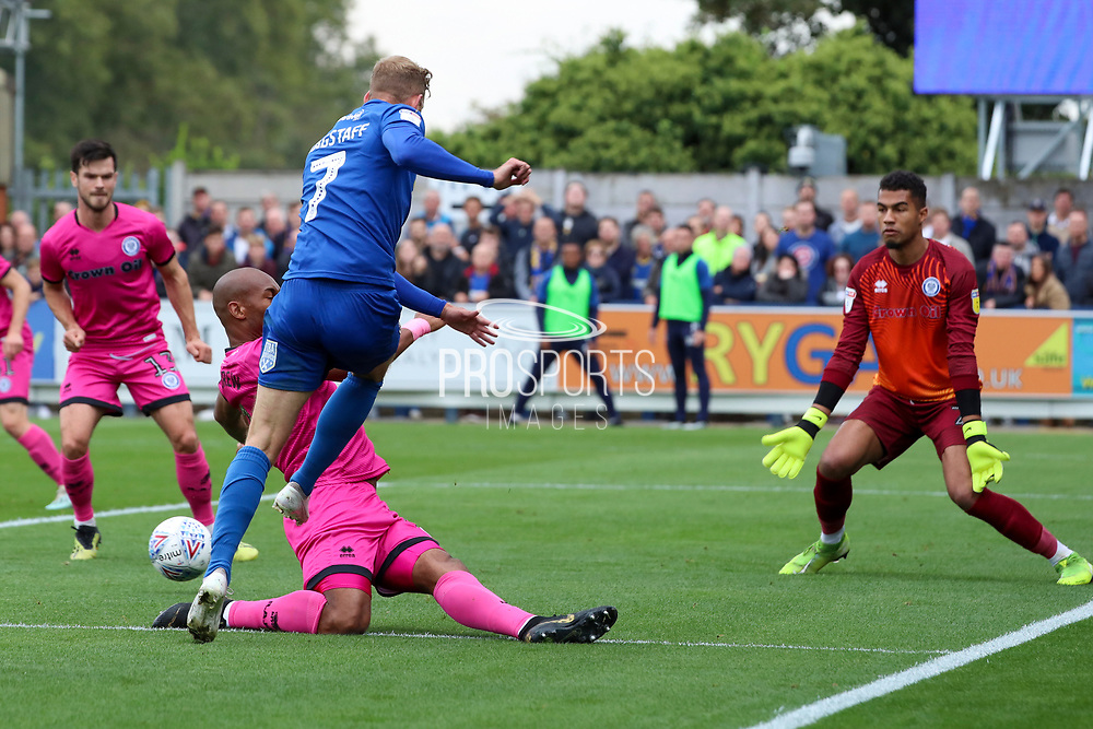 AFC Wimbledon midfielder Scott Wagstaff (7) pulling the ball back for AFC Wimbledon defender Paul Osew (37) to score during the EFL Sky Bet League 1 match between AFC Wimbledon and Rochdale at the Cherry Red Records Stadium, Kingston, England on 5 October 2019.