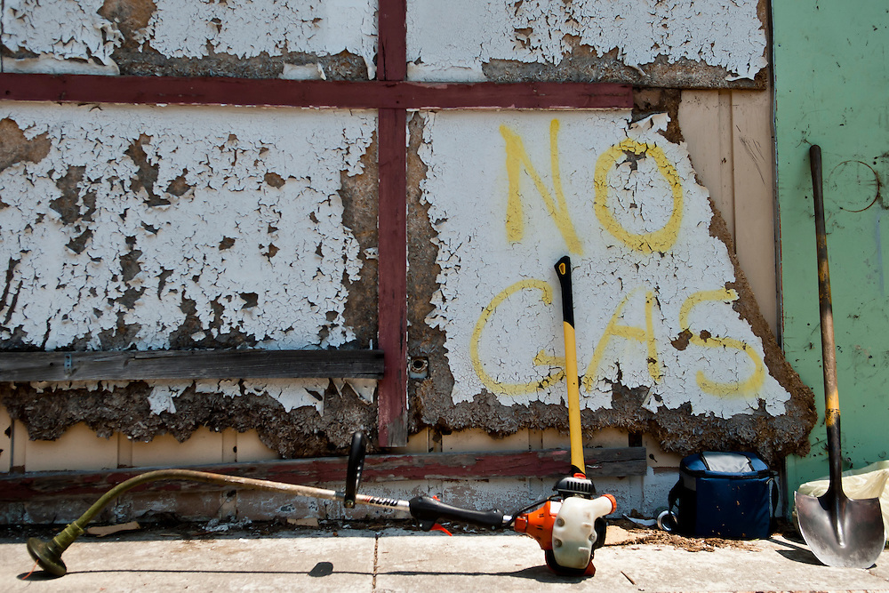 Lathan Goumas | MLive.com..Tools sit as workers rest for a few minutes while cleaning up an abandoned gas station and car wash on Martin Luther King Avenue near the intersection of Wood Street in Flint, Mich. on Tuesday June 19, 2012. They are working with the Flint Downtown Weed & Seed program, which is designed to provide transitional employment opportunities for ex-offenders.