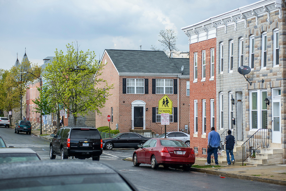 Baltimore, Maryland - April 30, 2015: Two blocks of older rowhomes on N. Carey Street the Sandtown neighborhood of Baltimore run perpendicular with a neighborhood of new town homes built in the 90's. After retiring as CEO of the Rouse corporation, Jim Rouse found the Enterprise Foundation, and aimed at revitalizing Sandtown. After he died, the project stalled, and the economics of Sandtown stayed the same. <br /> <br /> The poor, predominately black area of Baltimore known as Sandtown is where the most violent riots occurred the week Freddie Gray was laid to rest. Tensions between the are's residents and police have been bubbling long before Freddie Gray died while in police custody. <br /> <br /> CREDIT: Matt Roth for The Globe and Mail