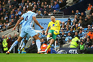 Picture by Paul Chesterton/Focus Images Ltd.  07904 640267.03/12/11.Steve Morison of Norwich has an early shot on goal during the Barclays Premier League match at the Etihad Stadium, Manchester.