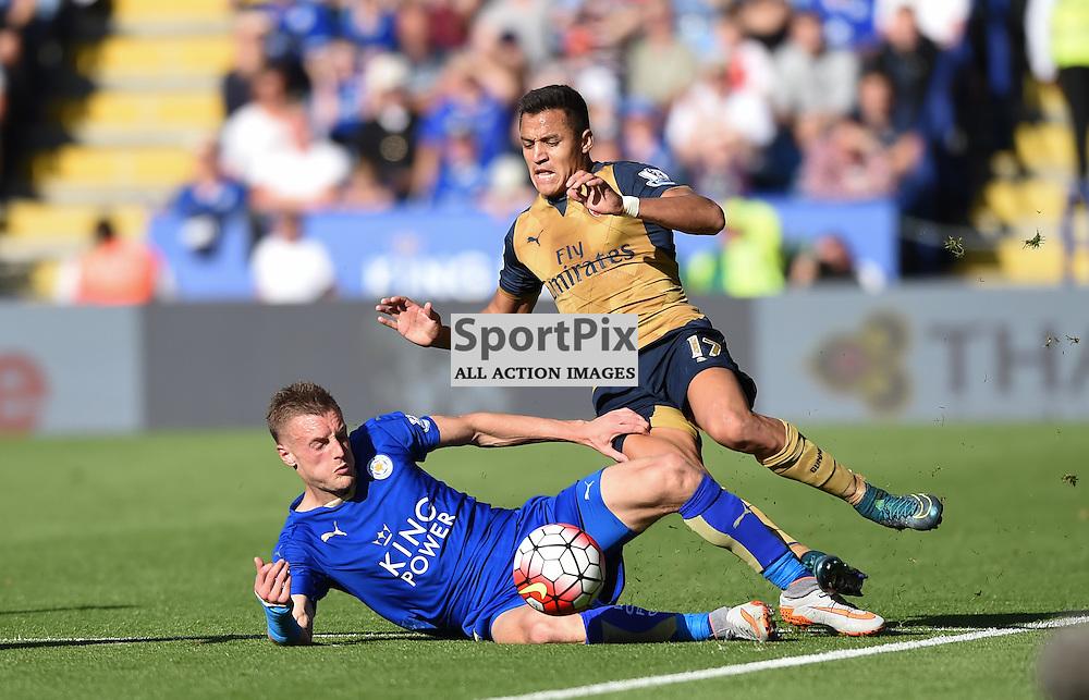 Jamie Vardy slides in to tackle Alexis Sanchez (c) Simon Kimber | SportPix.org.uk