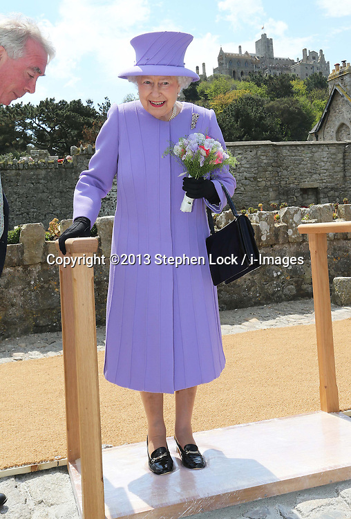 The Queen makes shoe prints in a soft cast during a visit to St.Michael's Mount in Cornwall, Friday, 17th May 2013, Picture by:  Stephen Lock / i-Images
