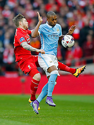 Fernandinho of Manchester City is challenged by Alberto Moreno of Liverpool - Mandatory byline: Rogan Thomson/JMP - 28/02/2016 - FOOTBALL - Wembley Stadium - London, England - Liverpool v Manchester City - Capital One Cup Final.
