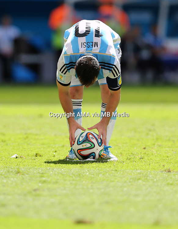 Lionel Messi of Argentina places the ball on the pitch