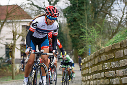 Carmen Small gasps for breathe as the top of Kapelmuur comes into view - Pajot Hills Classic 2016, a 122km road race starting and finishing in Gooik, on March 30th, 2016 in Vlaams Brabant, Belgium.