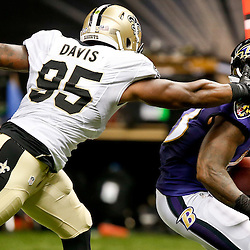 Aug 28, 2014; New Orleans, LA, USA; New Orleans Saints defensive end Cheta Ozougwu (95) reaches for Baltimore Ravens running back Fitzgerald Toussaint (43) during the second half of a preseason game at Mercedes-Benz Superdome. The Ravens defeated the Saints 22-13. Mandatory Credit: Derick E. Hingle-USA TODAY Sports