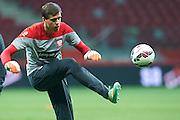 Poland's goalkeeper Wojciech Szczesny kicks the ball during official training one day before the EURO 2016 qualifying match between Poland and Germany on October 10, 2014 at the National stadium in Warsaw, Poland<br /> <br /> Picture also available in RAW (NEF) or TIFF format on special request.<br /> <br /> For editorial use only. Any commercial or promotional use requires permission.<br /> <br /> Mandatory credit:<br /> Photo by &copy; Adam Nurkiewicz / Mediasport