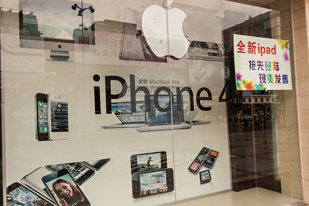 Sign in Chinese advertising the Apple iPhone and iPad in Beijing, China
