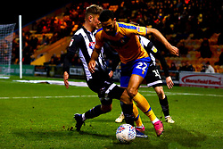 Luke Hendrie of Grimsby Town tackles CJ Hamilton of Mansfield Town - Mandatory by-line: Ryan Crockett/JMP - 04/01/2020 - FOOTBALL - One Call Stadium - Mansfield, England - Mansfield Town v Grimsby Town - Sky Bet League Two