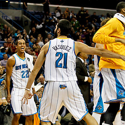 Jan 9, 2013; New Orleans, LA, USA; New Orleans Hornets point guard Greivis Vasquez (21) celebrates with teammates after scoring against the Houston Rockets during the second half of a game at the New Orleans Arena. The Hornets defeated the Rockets 88-79. Mandatory Credit: Derick E. Hingle-USA TODAY Sports