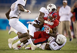 September 16, 2017 - Boca Raton, Florida, U.S. - Florida Atlantic Owls running back Kerrith Whyte Jr. (6) is tackled by Bethune Cookman Wildcats defensive back Arthur Williams (25) and Bethune Cookman Wildcats linebacker Devin James (31) in Boca Raton, Florida on September 16, 2017. (Credit Image: © Allen Eyestone/The Palm Beach Post via ZUMA Wire)