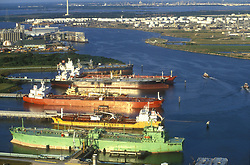 Oil tankers in the Port of Houston featuring the San Jacinto Monument.