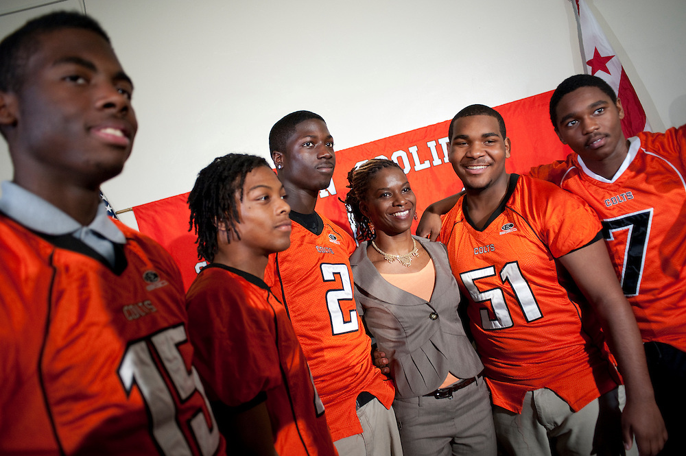 Mar 12,2010 - Washington, District of Columbia USA - .Natalie Randolph poses with some of her team at a press conference at Cavlin Coolidge Senior High School naming Randolph the school's new head football coach. She is believed to be the only woman coaching a high school varsity football team in the U.S...Randolph, 29, teaches biology and environmental sciences. She played for five years as a wide receiver for the D.C. Divas of the women's professional football league and was an assistant coach at H.D. Woodson High School in  D.C..(Credit Image: © Pete Marovich/ZUMA Press)