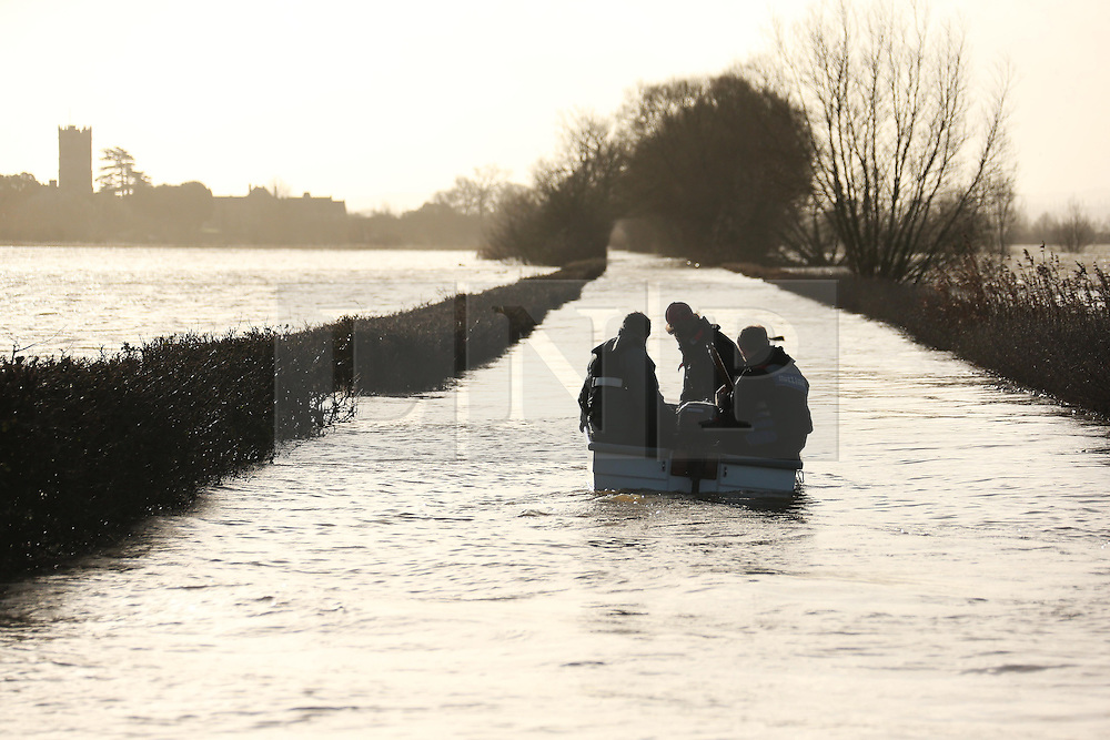 © Licensed to London News Pictures. 07/01/2014. MUCHELNEY, UK Flooding today 7th January 2014 in Muchelney in Somerset. Photo credit : Jason Bryant/LNP