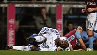 Photo: Paul Thomas.<br /> Aston Villa v Chelsea. The Barclays Premiership. 02/01/2007.<br /> <br /> Michael Essien (L) shows the pain from a Gavin McCann tackle.