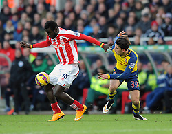 Stoke's Mame Biram Diouf on the ball under pressure from Arsenal's Hector Bellerin - Photo mandatory by-line: Dougie Allward/JMP - Mobile: 07966 386802 - 06/12/2014 - SPORT - Football - Stoke - Britannia Stadium - Stoke City v Arsenal - Barclays Premie League