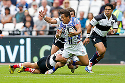 Samoa Full Back Tim Nanai-Williams is tackled by Barbarians Fly-Half Christian Leali'ifano (Brumbies & Australia) - Mandatory byline: Rogan Thomson/JMP - 07966 386802 - 29/08/2015 - RUGBY UNION - The Stadium at Queen Elizabeth Olympic Park - London, England - Barbarians v Samoa - International Friendly.