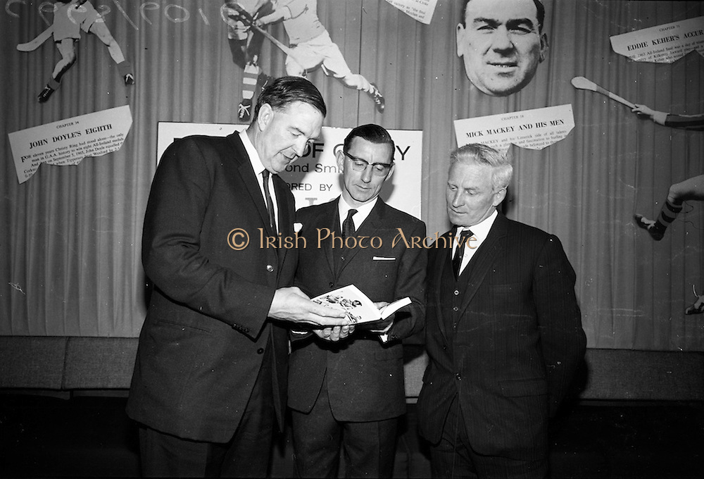 "17/05/1966<br /> 05/17/1966<br /> 17 May 1966<br /> Book reception for ""Decades of Glory: A Comprehensive History of the National Game"" by Raymond Smith.<br /> This reception was held in the offices of W.D. & H.O. Wills to honour the well known author and journalist, Raymond Smith. His book on the history of Hurling (""Decades of Glory"") has just been published with the assistance of Wills of Dublin and Cork and the Central Council of the G.A.A."