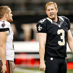 Dec 29, 2013; New Orleans, LA, USA; New Orleans Saints kicker Shayne Graham (3) talks with Tampa Bay Buccaneers punter Michael Koenen (9) prior to kickoff of a game at Mercedes-Benz Superdome. Mandatory Credit: Derick E. Hingle-USA TODAY Sports