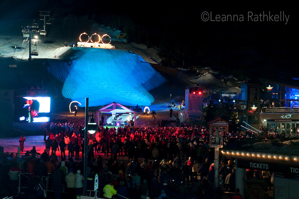 Every night local skiers and snowboarders jump through flaming hoops at the Fire and Ice show during the 2010 Olympic Winter Games in Whistler, BC Canada.