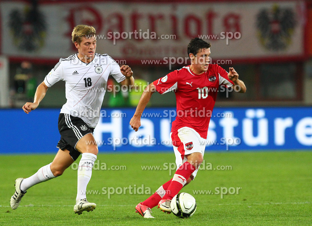11.09.2012, Ernst Happel Stadion, Wien, AUT, FIFA WM Qualifikation, Oesterreich vs Deutschland, im Bild Toni Kroos, (GER, #18) und Zlatko Junuzovic, (AUT, #10)  // during the FIFA World Cup Qualifier Match between Austria (AUT) and Germany (GER) at the Ernst Happel Stadion, Vienna, Austria on 2012/09/11. EXPA Pictures © 2012, PhotoCredit: EXPA/ Thomas Haumer