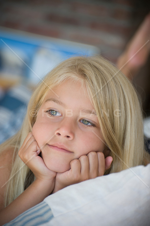 young blonde girl relaxing at home