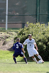 01 October 2006: Titan Steve Perona looks for a way past Crusader Robbie Burton. The game remained scoreless until the 2nd overtime in which University of Dallas Crusaders Adam Lunger scored the Golden Goal to beat the Illinois Wesleyan Titans.  This game was played at Neis Field on the campus of Illinois Wesleyan University in Bloomington Illinois.