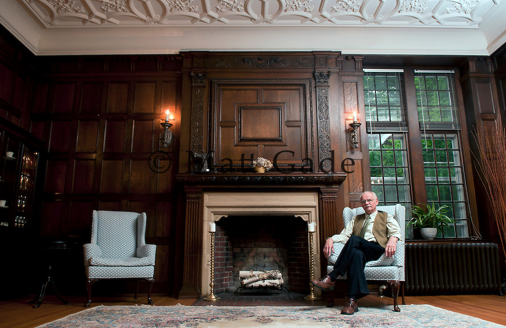 Gary Eberle, Professor of English and Master of the Revels (Aquinas College's 125th Anniversary), sits in the old dining room in Holmdene Hall. Holmdene Hall was built in 1908..Date Shot 9-8-2011.(Matt Gade | Grand Rapids Press)