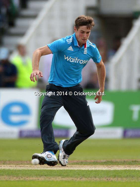 Chris Woakes fields off his own bowling during the third Royal London One Day International between England and India at Trent Bridge, Nottingham. Photo: Graham Morris/www.cricketpix.com (Tel: +44 (0)20 8969 4192; Email: graham@cricketpix.com) 300814