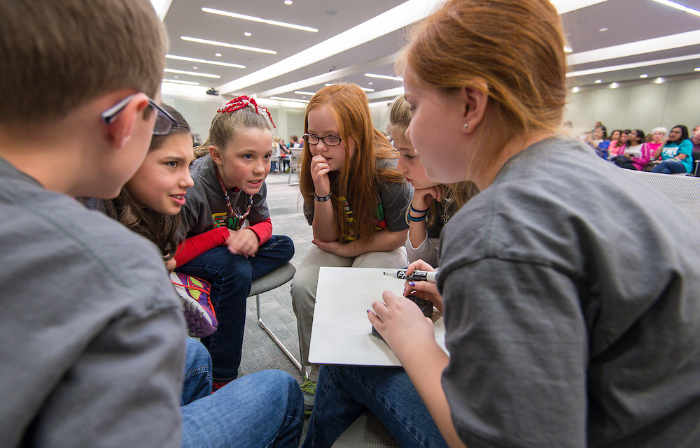 """Students participate in the """"Name That Book"""" competition, March 6, 2015."""