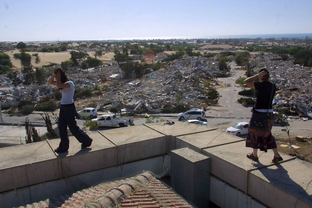 A Jewish settlers walks past mounds of rubble in the evacuated Jewish settlement of Neve Dekalim in Gush Katif in the Gaza Strip,