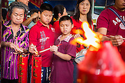 31 JANUARY 2014 - BANGKOK, THAILAND:   People make offerings at the Poh Teck Tung shrine during Lunar New Year festivities, also know as Tet and Chinese New Year, in Bangkok. This year is the Year of the Horse. Ethnic Chinese make up about 14% of Thailand and Chinese holidays are widely celebrated in Thailand.     PHOTO BY JACK KURTZ