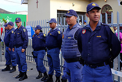 Police stand by as the residents cast their vote in Masiphumelele near Fish Hoek, Cape Town during the 2016 local government elections held across South Africa on the 3rd August 2016<br /> <br /> Photo by - Ron Gaunt / RealTime Images