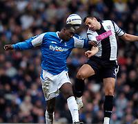 Photo: Richard Lane.<br />Birmingham City v West Bromwich Albion. The Barclays Premiership. 11/03/2006. <br />Birmingham's Emile Heskey (lt) is challenged by Neil Clement.