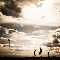Football players on Brighton beach U.K. A great silhouette.