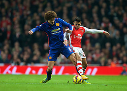 LONDON, ENGLAND - Saturday, November 22, 2014: Arsenal's Alexis Sanchez in action against Manchester United's Marouane Fellaini during the Premier League match at the Emirates Stadium. (Pic by David Rawcliffe/Propaganda)