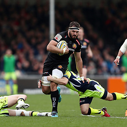 Don Armand of Exeter Chiefs is tackled by Faf De Klerk of Sale Sharks