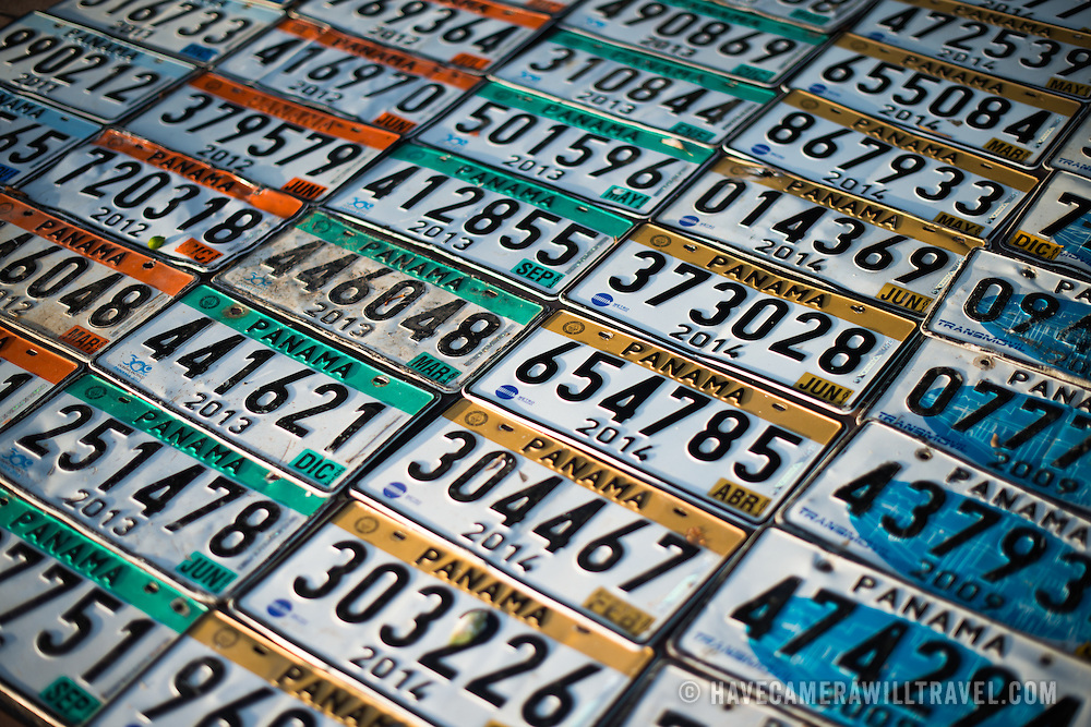 Rows of Panamanian license plates for sale at a street market in Panama City, Panama.