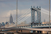 View of the Empire States Building across the Manhattan Bridge from the Brooklyn Bridge, New York