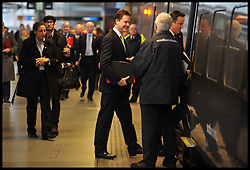 Britain's Prime Minister David Cameron (R) and Deputy Prime Minister Nick Clegg board a train at St Pancras rail station to attend a cabinet meeting at the 2012 Olympic Games site, Monday January 9, 2012. Photo By Andrew Parsons/ i-Images