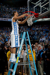 CHAPEL HILL, NC - MARCH 05: Kendall Marshall #5 of the North Carolina Tar Heels cuts down the net after defeating the Duke Blue Devils and winning the regular season ACC championship on March 05, 2011 at the Dean E. Smith Center in Chapel Hill, North Carolina. North Carolina won 67-81. (Photo by Peyton Williams/UNC/Getty Images) *** Local Caption *** Kendall Marshall