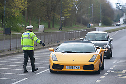 ©Licensed to London News Pictures 31/03/2020  <br /> Bexley, UK. Police officer stopping cars to check peoples movements while on lockdown. Motorcycle Met police carrying out speed checks and covid19 checks near Bexley Village, Bexley, Greater London. The Prime Minister Boris Johnson has asked people to stay at home to help in the fight against Covid-19 and to only go out for essential reasons. credit:Grant Falvey/LNP