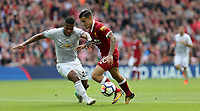 Football - 2017 / 2018 Premier League - Liverpool vs. Manchester United<br /> <br /> Philippe Coutinho of Liverpool and Antonio Valencia of Manchester United at Anfield.<br /> <br /> COLORSPORT/Joe Perch