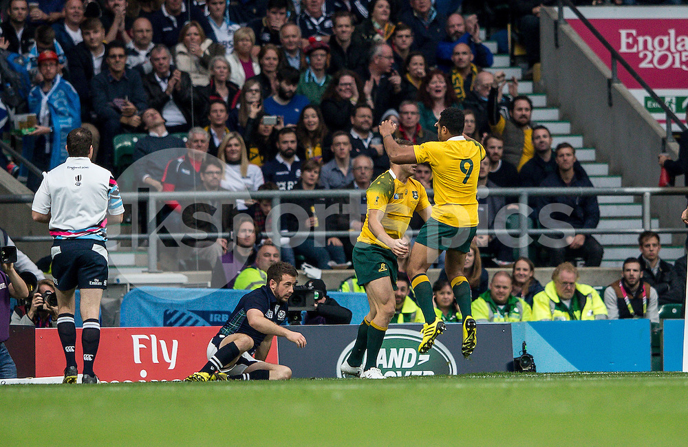 Drew Mitchell of Australia goes over to make it 22-19 during the Rugby World Cup Quarter Final match between Australia and Scotland played at Twickenham Stadium, London on the 18th of October 2015. Photo by Liam McAvoy.
