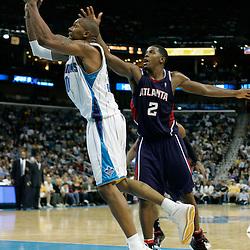 05 November 2008: New Orleans Hornets forward David West (30) shoots past Atlanta Hawks guard Joe Johnson (2) during a 87-79 victory by the Atlanta Hawks over the New Orleans Hornets at the New Orleans Arena in New Orleans, LA..