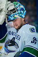 PENTICTON, CANADA - SEPTEMBER 8: Thatcher Demko #35 of Vancouver Canucks adjusts his mask during warm up against the Winnipeg Jets on September 8, 2017 at the South Okanagan Event Centre in Penticton, British Columbia, Canada.  (Photo by Marissa Baecker/Shoot the Breeze)  *** Local Caption ***