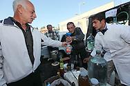 Decanting home-made vodka at a local market - Stepanakert, Nagorno-Karabakh
