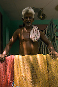 INDIA. Fisherman at his home in Serudhur village, Velankani. South India. Tamil Nadu State.
