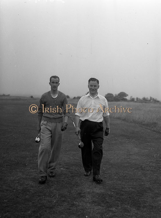 23/06/1959<br /> 06/23/1959<br /> 23 June 1959 <br /> Irish Amateur Close Golf Championships at Portmarnock, Dublin. Dr. William O'Sullivan,(right) (Killarney Golf Club) President of the Golfing Union of Ireland, who defeated T. Howlett (Tramore) in the third round of the Irish Amateur Close Golf Championships at the Portmarnock course, is pictured with Howlettt going to the 14th green.. He defeated Howlett 2 and 1.